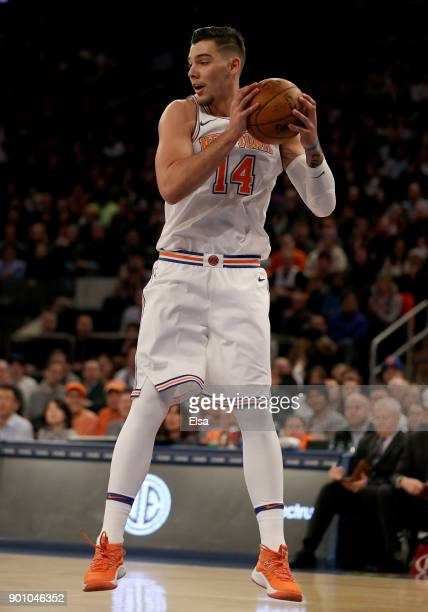 Willy Hernangomez of the New York Knicks grabs the rebound in the second half against the San Antonio Spurs at Madison Square Garden on January 02...