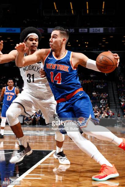 Willy Hernangomez of the New York Knicks handles the ball against the Brooklyn Nets during a preseason game on October 8 2017 at Barclays Center in...