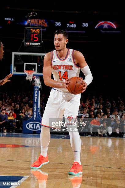 Willy Hernangomez of the New York Knicks handles the ball against the Washington Wizards on October 13 2017 at Madison Square Garden in New York City...