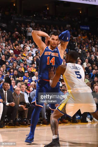 Willy Hernangomez of the New York Knicks handles the ball against the Golden State Warriors on January 23 2018 at ORACLE Arena in Oakland California...