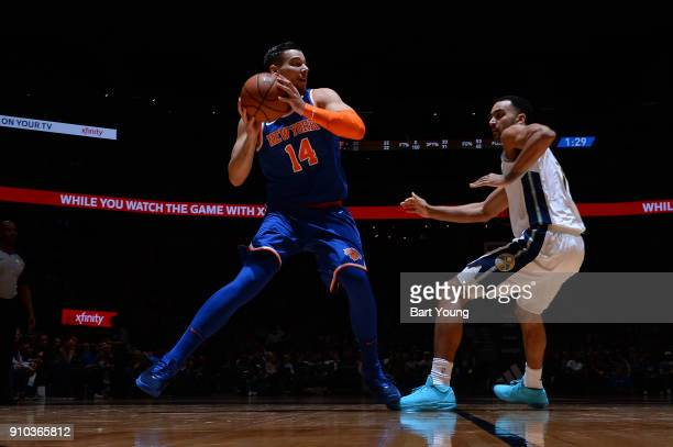 Willy Hernangomez of the New York Knicks passes the ball against Trey Lyles of the Denver Nuggets on January 25 2018 at the Pepsi Center in Denver...