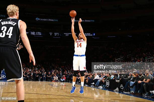Willy Hernangomez of the New York Knicks shoots the ball Brooklyn Nets at Madison Square Garden in New York City on October 8 2016 NOTE TO USER User...