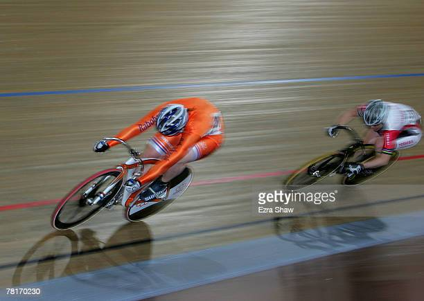 Willy Kanis of the Netherlands races past Anna Meares of Australia racing for Team Toshiba to win the women's sprint final during day one of the...