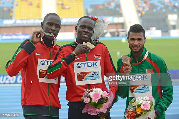 Willy Kiplimo Tarbei from Kenya , Kipyegon Bett from Kenya and Mostafa Smaili from Morocco on the podium in men's 800 metres during the IAAF World...