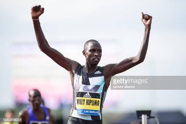 Willy Kiplimo Tarbei of Kenya celebrates after winning in the men's 800 metre race during the Adidas Boost Athletics Meeting in...