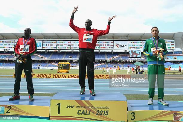 Willy Kiplimo Tarbei of Kenya, gold medal, Kipyegon Bett of Kenya, silver medal, and Luis Fernando Pires of Brazil, bronze medal, celebrate on the...