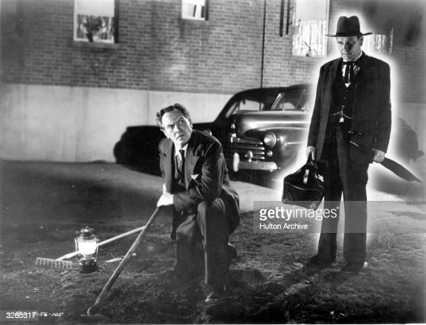 Willy Loman played by American actor Fredric March is visited by the ghost of his dead brother Ben played by Royal Beal in a scene from the film...