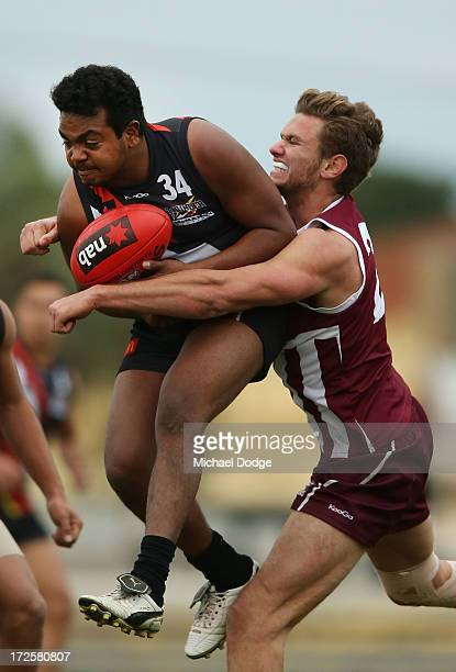 Willy Rioli Jnr of Northern Territory marks the ball against Cain Tickner of Queensland during the round five AFL Under 18s Championship match...