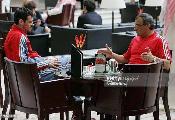 Willy Sagnol and Coach Felix Magath of Munich chat together in the lobby of the Emirates Tower Hotel as they prepare for the friendly match between...