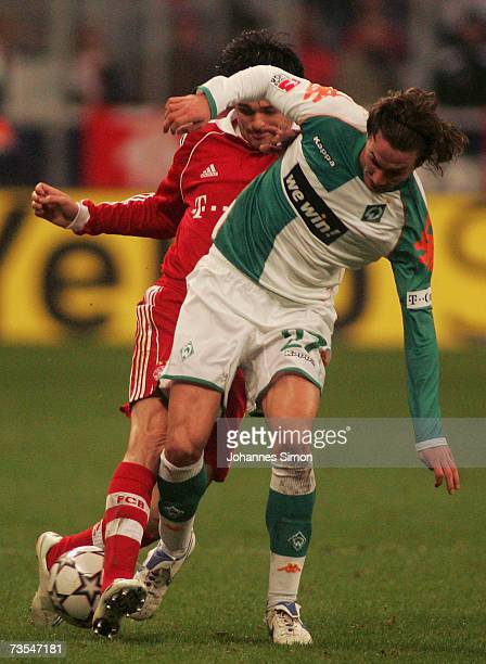 Willy Sagnol of Bayern Munich in action with Christian Schulz of Werder Bremen during the Bundesliga match between FC Bayern Munich and Werder Bremen...