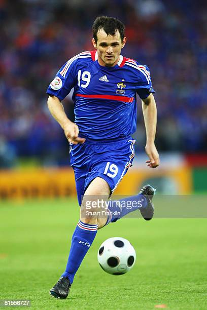 Willy Sagnol of France runs with the ball during the UEFA EURO 2008 Group C match between Netherlands and France at Stade de Suisse Wankdorf on June...