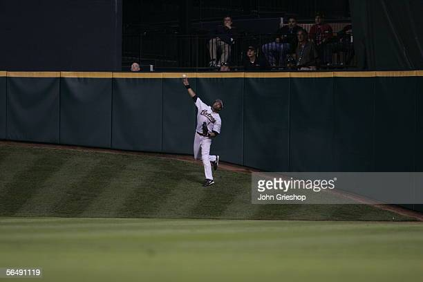 Willy Taveras of the Houston Astros fields upon the hill in centerfield during Game Three of the Major League Baseball World Series against the...