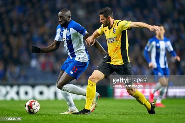 Willyan da Silva Rocha of Portimonense SC competes for the ball with Moussa Marega of FC Porto during the Liga Nos match between FC Porto and...