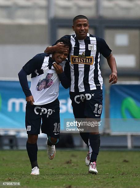 Willyan Mimbela of Alianza lima celebrates with his teammate after scoring during a match between Sporting Cristal and Alianza Lima as part of 8th...