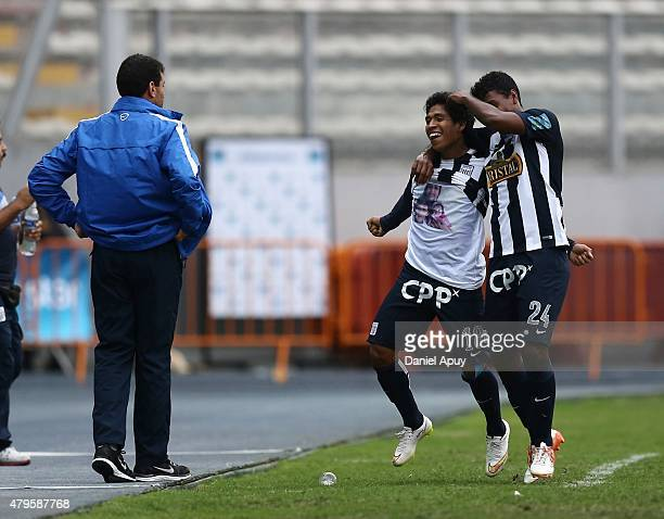 Willyan Mimbela of Alianza Lima celebrates with his teammate Miguel Araujo after scoring during a match between Sporting Cristal and Alianza Lima as...