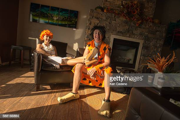 Wilma and Fred Flintstone Seanna Sacapano and Hunter Webster pose for a photo in their Halloween costumes at MegALatte coffee bar in Williston ND Oct...
