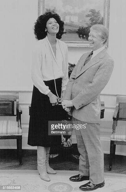 Wilma Rudolph, a triple gold medalist in the 1960 Olympics, calls on President Carter at the White House to talk about the upcoming games in Moscow.