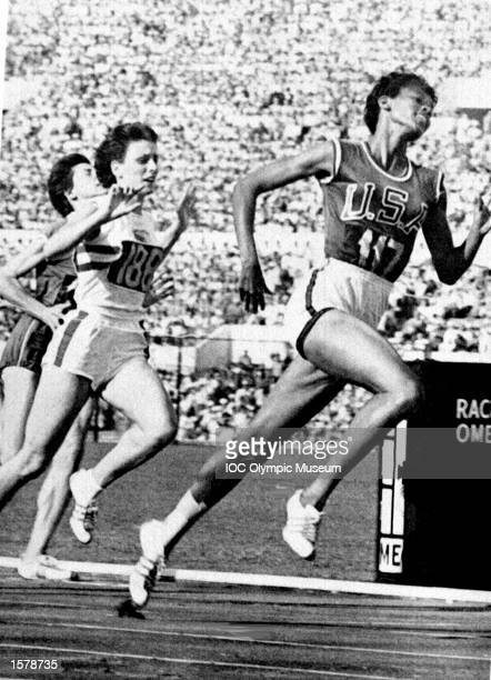 Wilma Rudolph of the USA beats Dorothy Hyman of Great Britain into second place to win the 100 metres final at the 1960 Olympic Games in Rome Rudolph...