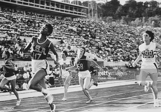 Wilma Rudolph of the USA wins the Gold Medal in the 100 meter sprint on August 3 1960 during the Summer Olympic Games in Rome Italy