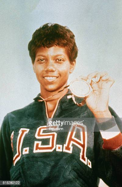 Wilma rudolph pictures and photos getty images wilma rudolph with her second gold medal she won for the 200meter dash at the olympics voltagebd Choice Image