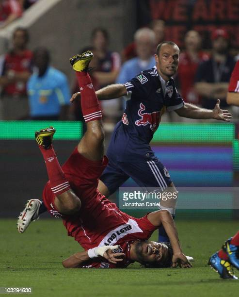 Wilman Conde of the Chicago Fire lands on his head after colliding with Joel Lindpere of the New York Red Bulls in an MLS match on August 8, 2010 at...