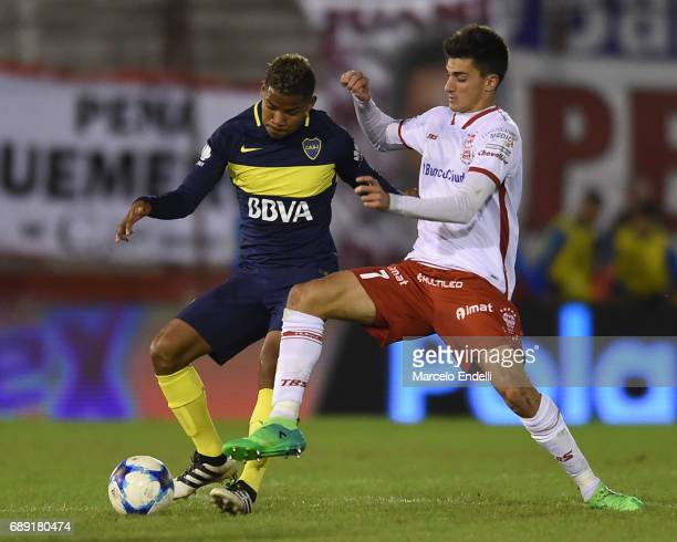 Wilmar Barrios of Boca Juniors fights for ball with Ignacio Pussetto of Huracan during a match between Huracan and Boca Juniors as part of Torneo...
