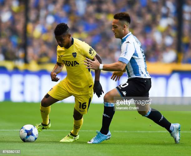 Wilmar Barrios of Boca Juniors fights for ball with Lautaro Martinez of Racing Club during a match between Boca Juniors and Racing Club as part of...
