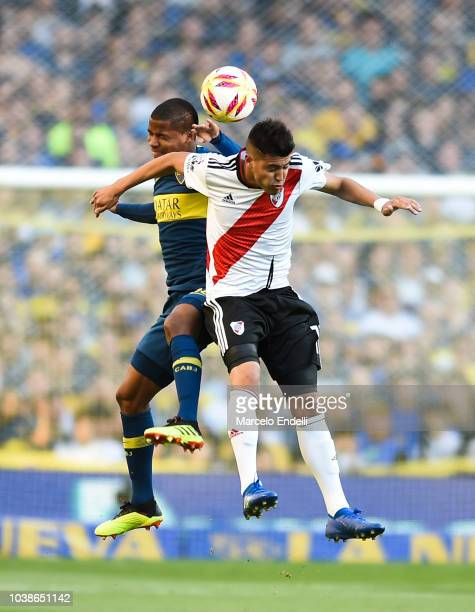Wilmar Barrios of Boca Juniors fights for the ball with Exequiel Palacios of River Plate during a match between Boca Juniors and River Plate as part...