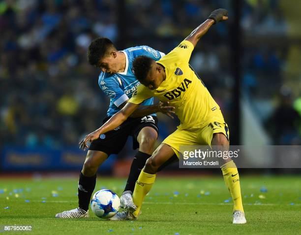 Wilmar Barrios of Boca Juniors fights for the ball with Juan Brunetta of Belgrano during a match between Boca Juniors and Belgrano as part of...