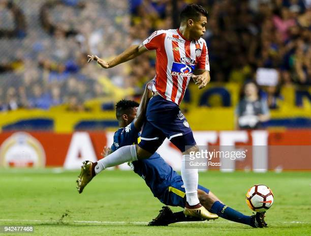 Wilmar Barrios of Boca Juniors fights for the ball with Teofilo Gutierrez of Junior during a group phase match between Boca Juniors and Junior as...