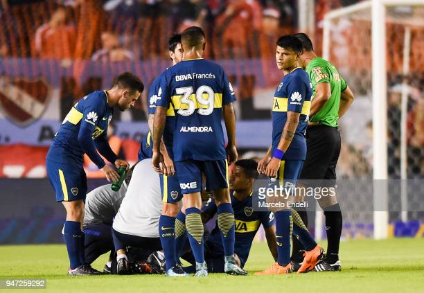 Wilmar Barrios of Boca Juniors receives medical aid after being injured during a match between Independiente and Boca Juniors as part of Superliga...