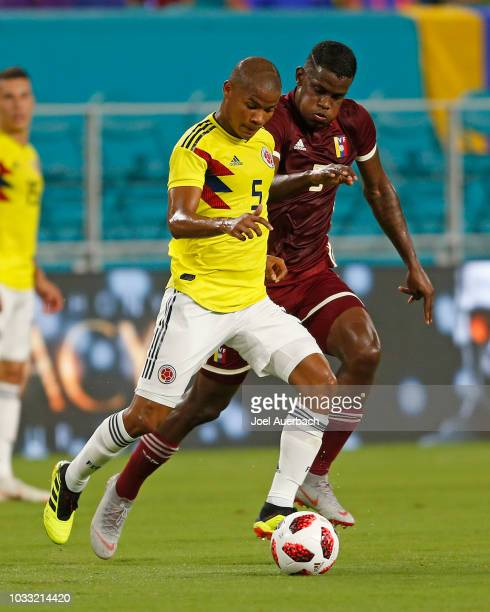 Wilmar Barrios of Colombia and Sergio Cordova of Venezuela battle for control of the ball during an International friendly match on September 7 2018...