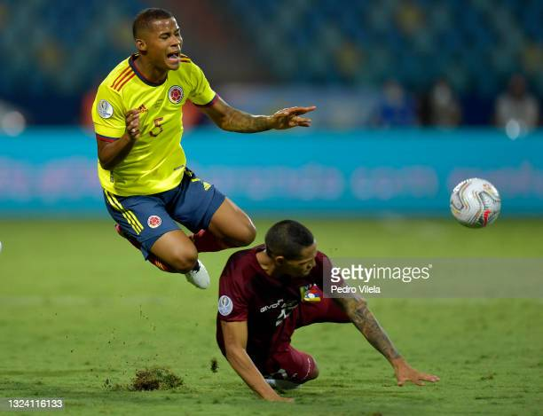 Wilmar Barrios of Colombia falls down against Yohan Cumana of Venezuela during a Group B match between Colombia and Venezuela as part of Copa America...