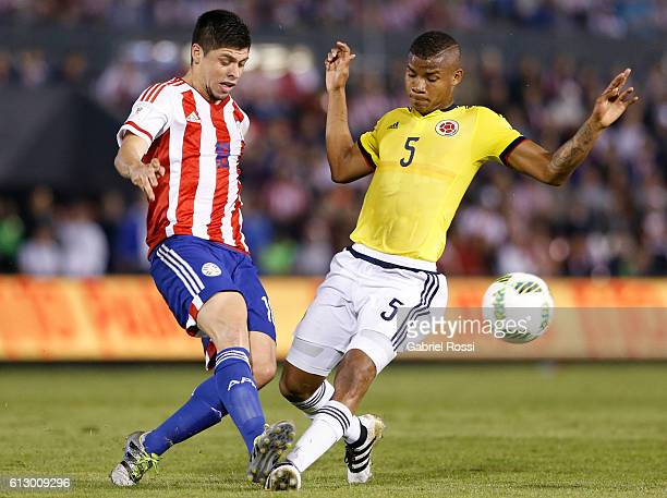 Wilmar Barrios of Colombia fights for the ball with Rodrigo Rojas of Paraguay during a match between Paraguay and Colombia as part of FIFA 2018 World...