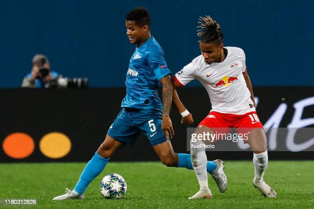 Wilmar Barrios of FC Zenit Saint Petersburg and Christopher Nkunku of RB Leipzig vie for the ball during the UEFA Champions League Group G match...