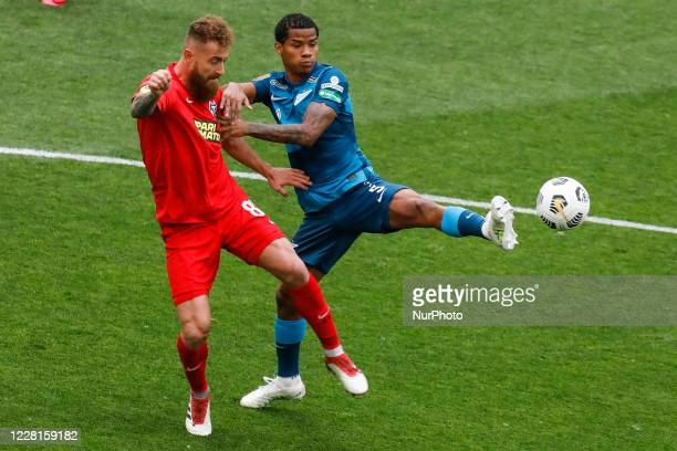 Wilmar Barrios of Zenit Saint Petersburg and Aleksandre Karapetian of Tambov vie for the ball during the Russian Premier League match between FC...