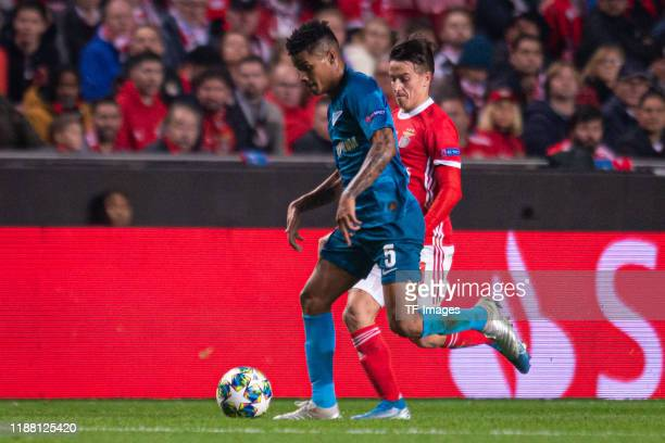 Wilmar Barrios of Zenit St Petersburg and Franco Cervi of SL Benfica battle for the ball during the UEFA Champions League group G match between SL...