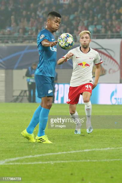 Wilmar Barrios of Zenit St Petersburg and Kevin Kampl of RB Leipzig battle for the ball during the UEFA Champions League group G match between RB...