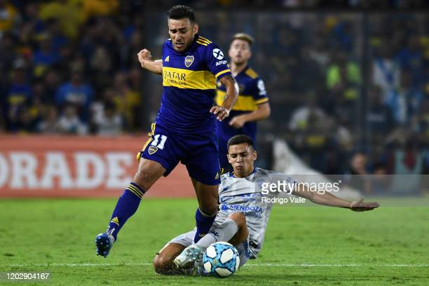 Wilmar Cartagena of Godoy Cruz competes for the ball with Eduardo Salvio of Boca Juniors during a match between Boca Juniors and Godoy Cruz as part...