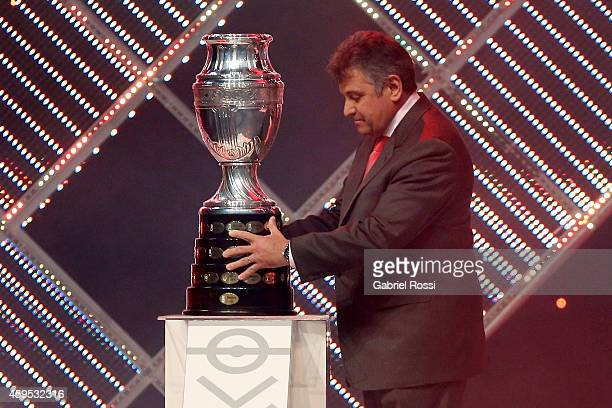 Wilmar Valdez President of the Uruguayan Football Association places the trophy of the Copa America on the plinth during the Official Draw of Copa...