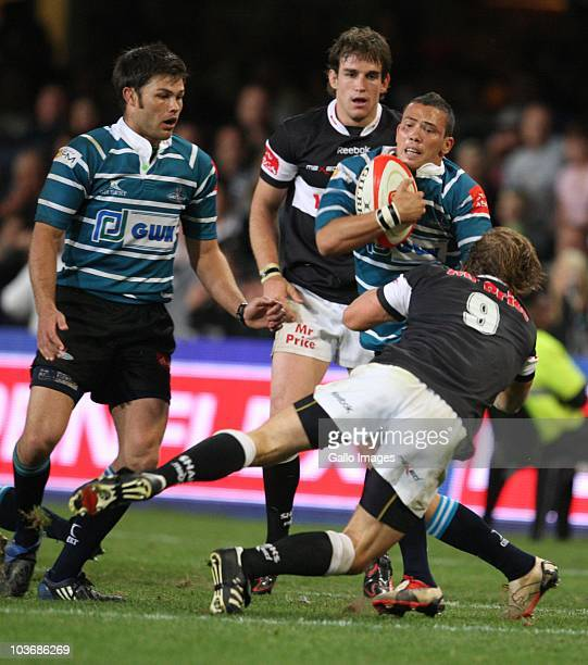 Wilmaure Louw of Griquas is tackled by Charl McLeod during the Absa Currie Cup match between the Sharks and GWK Griquas at Absa Stadium on August 27,...