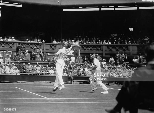 Wilmer Allison and John Van Ryn of the USA in action during their Davis Cup Challenge Round doubles match against Raymond Tuckey and Pat Hughes of...