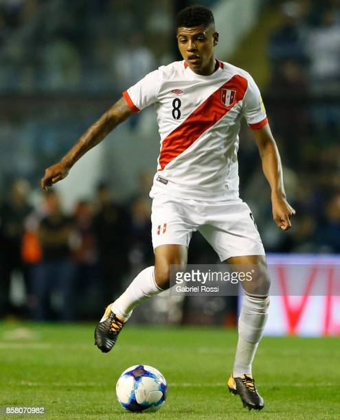 Wilmer Cartagena of Peru drives the ball during a match between Argentina and Peru as part of FIFA 2018 World Cup Qualifiers at Estadio Alberto J...