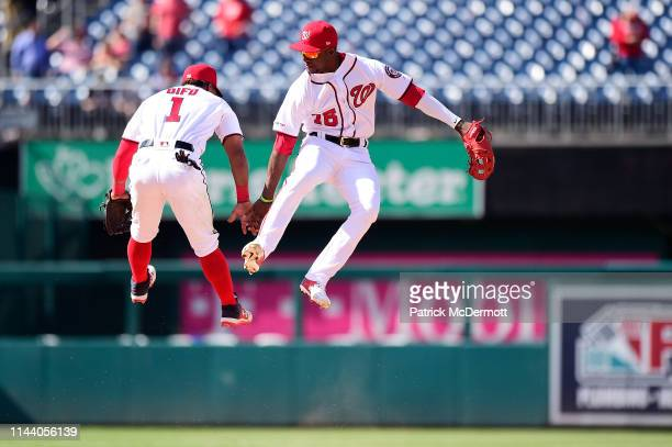 Wilmer Difo and Victor Robles of the Washington Nationals celebrate after the Nationals defeated the New York Mets 76 at Nationals Park on May 16...