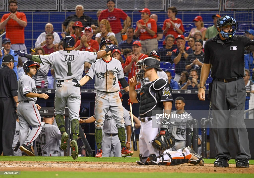 Wilmer Difo #1 of the Washington Nationals celebrates with teammates in the dugout after hitting a homerun to tie the game during the eighth inning against the Miami Marlins at Marlins Park on May 26, 2018 in Miami, Florida.