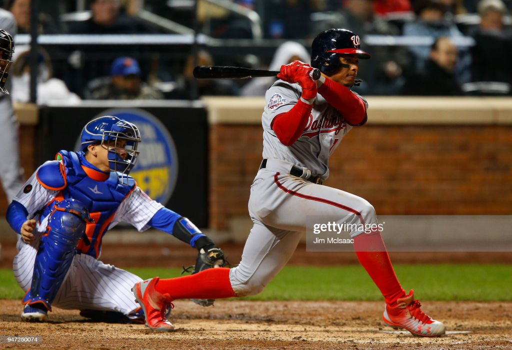 Wilmer Difo #1 of the Washington Nationals follows through on an eighth inning two run single against the New York Mets at Citi Field on April 16, 2018 in the Flushing neighborhood of the Queens borough of New York City.