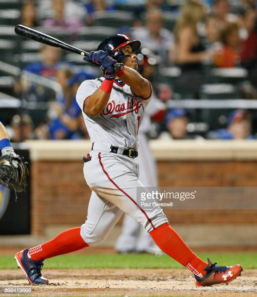 Wilmer Difo of the Washington Nationals hits a long fly ball in an MLB baseball game against the New York Mets on September 22 2017 at CitiField in...