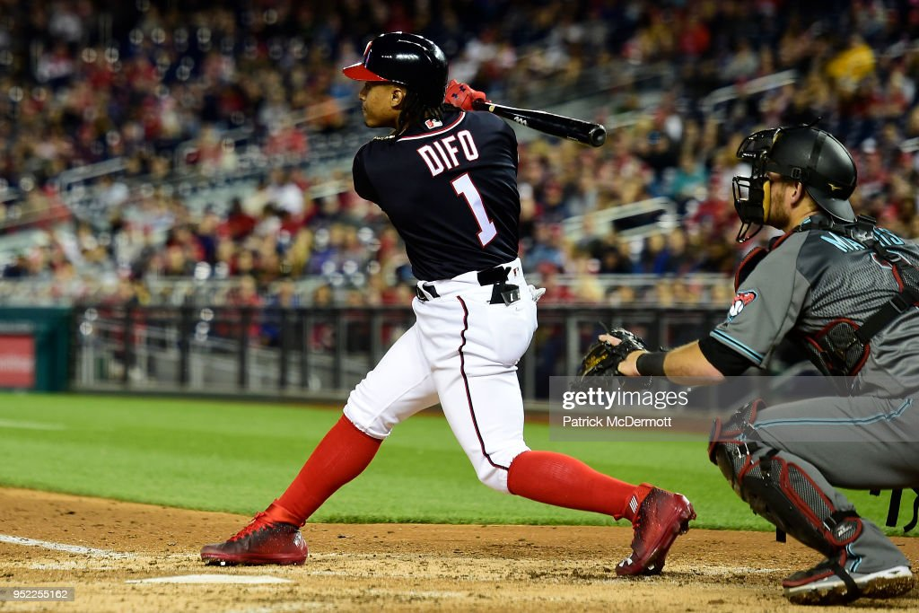 Wilmer Difo #1 of the Washington Nationals hits a sacrifice fly to center scoring Matt Adams #15 (not pictured) in the fifth inning Arizona Diamondbacks at Nationals Park on April 27, 2018 in Washington, DC.