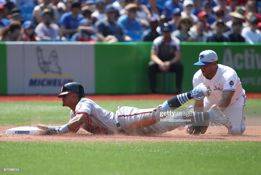 Wilmer Difo #1 of the Washington Nationals is thrown out at third in the sixth inning as he tries to advance from first base on a double during MLB game action as Yangervis Solarte #26 of the Toronto Blue Jays tags him out at Rogers Centre on June 17, 2018 in Toronto, Canada.