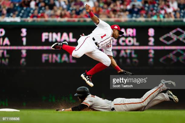 Wilmer Difo of the Washington Nationals is unable to retire Mac Williamson of the San Francisco Giants during the seventh inning at Nationals Park on...